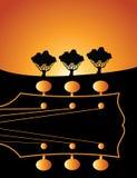 Cabezal de la guitarra en la salida del sol Foto de archivo