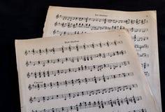Cabezal y partitura de la guitarra Fotografía de archivo libre de regalías