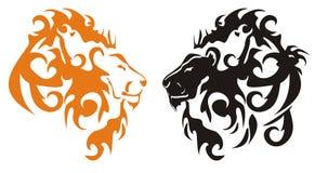 Cabezas tribales negras y anaranjadas de los leones Imagenes de archivo