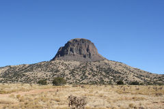 Cabezon Peak one. Cabezon Peak, a volcanic core rock formation that resembles the more famous Devil's Tower, in the desert of central New Mexico Stock Image