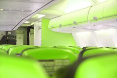 Cabgreen ine. Inside a airplane cabine with green seats Stock Photos