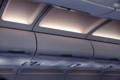 Cabin. Inside the aircraft, lights and signs Royalty Free Stock Image