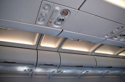 Cabin. Inside the aircraft, lights and signs royalty free stock photography