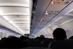 Cabin. A view of a fully occupied cabin of a commercial passnger aircraft Royalty Free Stock Images