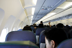Cabin. A view of a fully occupied cabin of a commercial passenger aircraft stock photo