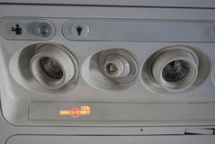 Cabin. Inside the aircraft, lights, air condition and signs panel above the seat Stock Photo