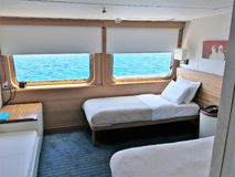 Cabin accommodations on the Galapagos legend Cruise Ship. GALAPAGOS, ECUADOR - FEBRUARY 20, 2017: Cabin accommodations on the Galapagos Legend Cruise Ship royalty free stock photos