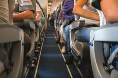 Cabin of airplane with passengers on seats. Cabin of airplane with unrecognizable passengers on seats waiting to take off Stock Photography