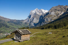 Cabin in the Alps Switserland. Cabin in the Alps in Switserland in Grindelwald with in the background the Wetterhorn Stock Images