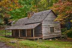 Cabin in the Autumn Woods Royalty Free Stock Photo
