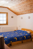 Cabin bedroom. Simple and comfortable mountain cabin bedroom Royalty Free Stock Photo