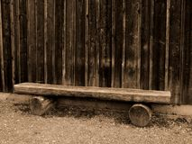 Cabin Bench. Lonely bench by wood cabin royalty free stock photography