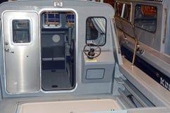 Cabin boat, steering wheel, dashboard, deck Stock Photos