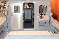 Cabin boat, steering wheel, dashboard, deck Royalty Free Stock Photos