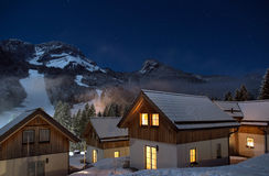 Cabin. S in the mountains a winter night Stock Photography