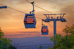 Cabin of cableway stands out Barcelona's sunset Stock Images