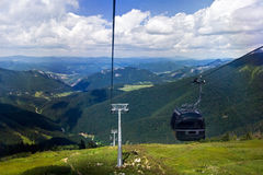 Cabin chair-lift Stock Images
