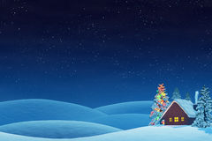 Cabin and Christmas tree in rolling winter landscape at night Stock Images