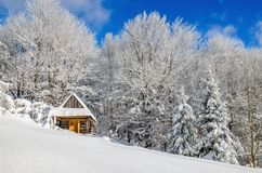 Cabin covered with snow in hills, Poland Royalty Free Stock Photos