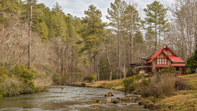 Cabin by the creek Royalty Free Stock Image