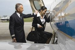 Cabin crew member and plot entering a private airplane Stock Photo