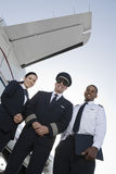 Cabin Crew Members Standing Together At Airfield Royalty Free Stock Image