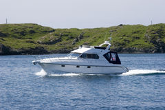 Cabin Cruiser. Recreational yacht in the harbor royalty free stock images