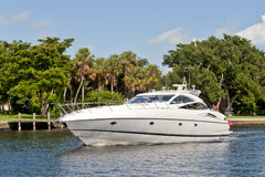 Cabin cruiser on river. Luxurious modern cabin cruiser boat on New river with trees in background, Fort Lauderdale, Miami, Florida, U.S.A Stock Photography