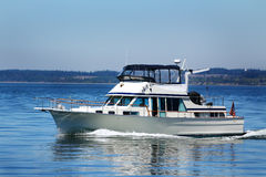 Cabin Cruiser. A cabin cruiser running just off shore at Hope Island State Park in Puget Sound Washington Royalty Free Stock Photo