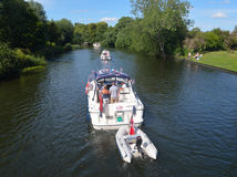 Cabin Cruisers on the river Ouse at St Neots. St Neots, Cambridgeshire, England - July 04, 2015: Cabin Cruisers on the river Ouse at St Neots Stock Images