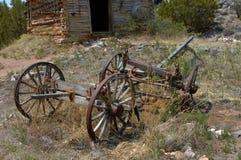 Cabin and Dilapadated Wagon Frame Royalty Free Stock Photo