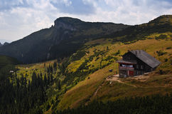 The Cabin Dochia in Ceahlau Mountains. The Cabin Dochia, a resort in a peak of  Ceahlau Mountains Royalty Free Stock Photos