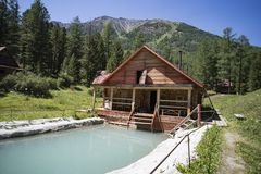 Cabin on the edge of a lake, Wooden two-storey cottage. Cabin in the woods. The tourist base for a stay in the forest. Cabin on the edge of a lake. Wooden two stock photography