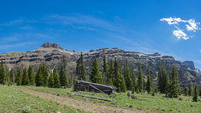 Cabin In Front of Mountain Range Stock Photos