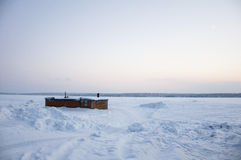 Cabin on a frozen lake Stock Image