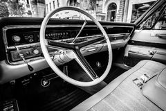 Cabin of a full-size luxury car Buick Electra 225 Limited, 1967. Black and white. Stock Photos