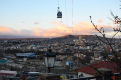 The cabin of funicular above the Old Town of Tbilisi in the evening. Top View. Top View of the Old City of Tbilisi in the evening royalty free stock photography