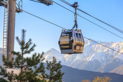 Cabin of funicular on the background of snow-capped mountains at sunset Royalty Free Stock Photography
