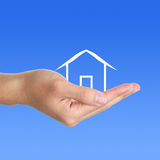 Cabin In hand. Hand with small cabin on white background. Which can used for the theme of family and so on royalty free stock image