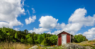 Cabin high up on the mountain. Small cabin high up on the mountain on the west coast of Sweden with beautiful background of clouds and forest Stock Image