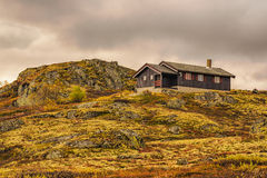 Cabin on hill in Hardangervidda National Park, Norway Royalty Free Stock Image