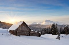 Cabin In The Mountains In Winter Stock Photos