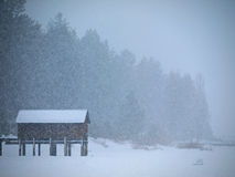 Cabin Isolated in Heavy Snow Stock Photo