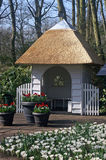 Cabin in the Keukenhof. Little white cabin with spring flowers in the famous flowerbulbgarden Keukenhof in Holland Royalty Free Stock Photos