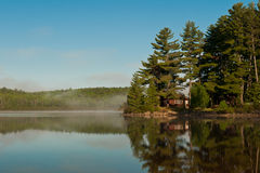 Cabin on lake. Peaceful log cabin on a Northern Ontario lake Royalty Free Stock Photo