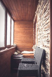 Cabin lodge interior in vintage nautical style decorated with wood planks and stone with big windows wooden barrel and bar chairs Royalty Free Stock Photo