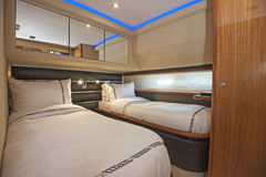 Cabin in a luxury private motor yacht Stock Photos