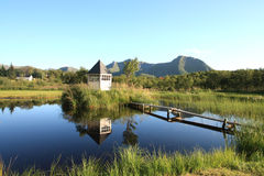 Cabin mirroring in Lofoten's lake Stock Photos