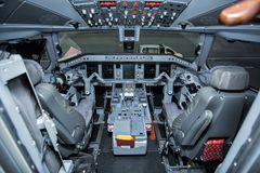 The cabin of the modern passenger airliner, nobody, autopilot. stock photography
