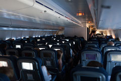 Cabin of modern passenger airplane Stock Images